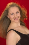 woman on red background with hair blowing