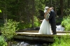 Bride and Groom kissing on small bridge