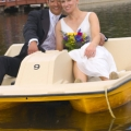 Bride and Groom up close in paddle boat